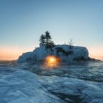 The sun shines through the hole in Hollow Rock on just a handful of days a year