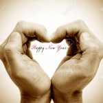 10712420-hands-forming-a-heart-and-the-sentence-happy-new-year